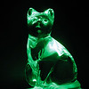 "02/17/10 - Green Cat<br /> I bought this glass cat at the thrift store last weekend with the thought of setting him on my LCD light stand and seeing how he'd look.  Pretty cool I guess although his head tilted up into that typical proud cat position reduced the detail on his face I think (despite me trying to correct for that).  I used the spot healing brush to clean up a few bubbles and scratches in the glass, and I cropped just a bit too.<br /> <br /> Thank you all so so much for your comments on the titmouse picture from yesterday...<br /> <br /> Joey was super duper excited about the comments on his picture yesterday.  We did not have time to shoot pictures last night.  We had to do homework.  But, he's very motivated thanks to your encouragement.  This will get a tad easier, as it will for all of us, once the weather warms up and the days get longer.  Here is a shot Johnny took at the same time Joey was taking the wooden woodpecker shots:<br />  <a href=""http://fotomom.smugmug.com/Daily-Photos/LightningFastJoeys-POTD/11187845_dd7pS#790529829_9Ppvs"">http://fotomom.smugmug.com/Daily-Photos/LightningFastJoeys-POTD/11187845_dd7pS#790529829_9Ppvs</a><br /> <br /> HAGD,<br /> Maryann"
