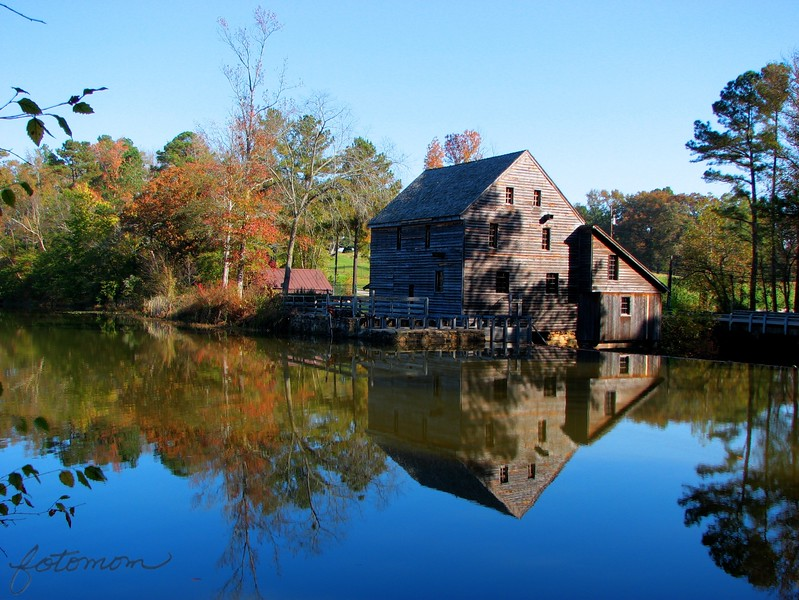 "11/6/09 - Yates Mill Revisited<br /> A heartfelt thanks goes out from me to everyone that took a minute to look at my POTD yesterday and leave a comment whether you just enjoyed the reflection or threw in some helpful hints. <br /> <br /> In the spirit of trying to improve, I went back to Yates Mill yesterday and took some more pictures.  This was before most of the comments!  I turned on bracketing (takes 3 shots on my camera) hoping to catch a good image. I figured I might launch the trial version of PhotoMatrix that I loaded up a while ago and know virtually nothing about.  Today's POTD is the result of running the 3 bracketed pictures through PhotoMatrix and basically accepting what it wanted to do.  I guess this is not the HDR output but just a tonal color mapping.  I have a lot more to read up on!<br /> <br /> The 'middle' original for today's POTD:<br /> <a href=""http://fotomom.smugmug.com/Yates-Mill-Pond/Yates-Mill-110409/10211182_2RaVN#704217195_Favig"">http://fotomom.smugmug.com/Yates-Mill-Pond/Yates-Mill-110409/10211182_2RaVN#704217195_Favig</a><br /> <br /> That said, today's POTD was taken at 9:30AM vs. 5:30PM for yesterday's POTD.  The crop is different.  It's somewhat an apples and oranges comparison.    <br /> <br /> No doubt the color in today's POTD is better sooc and processed.  But there is shade on the mill that I don't like that takes away from this one.  I think that keeps this shot from being a real winner too.  If only I could have waited out the sun, but I couldn't:-(  <br /> <br /> I like the water reflection and detail of the mill better in yesterday's POTD, but that's just a personal preference.   <br /> <br /> I typically shoot in AV mode.  I do go to M or TV or something else when it seems to work.  I have histogram, but I've not read up on how to use it.  Always more to learn.  <br /> <br /> Maybe if I'm lucky, persistent, and the moon and stars line up just right, I'll get THE shot.  There's a photo contest in February for the mill that I'll enter with whatever is the best shot I can manage.<br /> <br /> If any of you all are ever in Raleigh, I'd love to meet up with you at the mill and take a few shots. Photo ops abound there.<br /> <br /> More pictures of my two most recent trips to the mill are here:<br /> <a href=""http://fotomom.smugmug.com/Yates-Mill-Pond/Yates-Mill-110409/10211182_2RaVN#704204378_dE4yv"">http://fotomom.smugmug.com/Yates-Mill-Pond/Yates-Mill-110409/10211182_2RaVN#704204378_dE4yv</a><br /> There are a few gems in there among the rest.<br /> <br /> HAGD,<br /> Maryann"