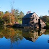 """11/6/09 - Yates Mill Revisited<br /> A heartfelt thanks goes out from me to everyone that took a minute to look at my POTD yesterday and leave a comment whether you just enjoyed the reflection or threw in some helpful hints. <br /> <br /> In the spirit of trying to improve, I went back to Yates Mill yesterday and took some more pictures.  This was before most of the comments!  I turned on bracketing (takes 3 shots on my camera) hoping to catch a good image. I figured I might launch the trial version of PhotoMatrix that I loaded up a while ago and know virtually nothing about.  Today's POTD is the result of running the 3 bracketed pictures through PhotoMatrix and basically accepting what it wanted to do.  I guess this is not the HDR output but just a tonal color mapping.  I have a lot more to read up on!<br /> <br /> The 'middle' original for today's POTD:<br /> <a href=""""http://fotomom.smugmug.com/Yates-Mill-Pond/Yates-Mill-110409/10211182_2RaVN#704217195_Favig"""">http://fotomom.smugmug.com/Yates-Mill-Pond/Yates-Mill-110409/10211182_2RaVN#704217195_Favig</a><br /> <br /> That said, today's POTD was taken at 9:30AM vs. 5:30PM for yesterday's POTD.  The crop is different.  It's somewhat an apples and oranges comparison.    <br /> <br /> No doubt the color in today's POTD is better sooc and processed.  But there is shade on the mill that I don't like that takes away from this one.  I think that keeps this shot from being a real winner too.  If only I could have waited out the sun, but I couldn't:-(  <br /> <br /> I like the water reflection and detail of the mill better in yesterday's POTD, but that's just a personal preference.   <br /> <br /> I typically shoot in AV mode.  I do go to M or TV or something else when it seems to work.  I have histogram, but I've not read up on how to use it.  Always more to learn.  <br /> <br /> Maybe if I'm lucky, persistent, and the moon and stars line up just right, I'll get THE shot.  There's a photo contest in February for the mill th"""