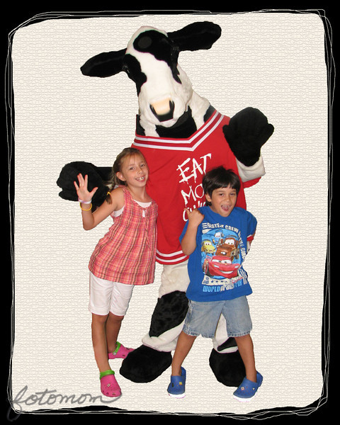 "06/22/11 - Smiles with the Chick-fil-A Cow<br /> <br /> The only pictures I took yesterday were at Chick-fil-A (CFA).  The kids are super crazy over the cow, and this particular cow comes with a lot of character.  I liked the enthusiasm of the kids in this shot which was snapped quickly while I was ordering.  The background was a bit busy, so I thought I'd try to pull the kids out of the background.  That's always easier said than done, and I'm sure some of you could have done it better.  <br /> <br /> Original:<br /> <br /> <a href=""http://fotomom.smugmug.com/Nature/June-2011/17389966_Qt2vxj#1348697450_fVpZrpN"">http://fotomom.smugmug.com/Nature/June-2011/17389966_Qt2vxj#1348697450_fVpZrpN</a><br /> <br /> Collage of the best CFA shots:<br /> <br /> <a href=""http://fotomom.smugmug.com/Nature/June-2011/17389966_Qt2vxj#1348698005_hmN9Hjs"">http://fotomom.smugmug.com/Nature/June-2011/17389966_Qt2vxj#1348698005_hmN9Hjs</a><br /> My second favorite shot is definitely Joey smiling with the cow.  <br /> <br /> Thanks for all your comments yesterday on both my daily and shots in my staging gallery and older shots too...<br /> <br /> HAGD,<br /> Maryann"