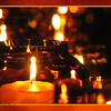 "2/3/11- Romance<br /> <br /> The center shot is another shot from The Candle Machine photo shoot.  This one looks more normal:-)  It's just a closer shot of the candles as they enter the machine.  I cleaned it up like I did the other shot removing noise with Noiseware, cropping to 8X10, and fixing a few large spots that caught my eye.  The background shot I took yesterday during the day as the candles burned.  It is an upshot into the melted candle wax from the bottom of the candle holder.  Joey here editing with me this AM said the center shot needed the yellow border.  We tried black, brown, bright yellow, and the yellow one.  It was a toss up for me between black or yellow, but the yellow does provide the more distinctive border.  <br /> <br /> Gotta laugh because the background shot had a black spot in the middle, and when I pulled it up Joey said, ""You know, Mom, you can get rid of that spot.""   ""Oh, really?""  ""Yeah, you told me you can get rid of spots.""  :-)  Waa laa!  Gone!  The fact that the foreground shot covers it...well who cares.  In a year he'll be editing my shots...<br /> <br /> Been falling asleep at night without finishing my editing.  Frustrating.  Mornings are not a good time to edit...<br /> <br /> Thank you very much for the response to yesterday's shot.   I highly recommend fun with mirrors and candles.  You need at least a votive and two 12X12 squares.  Better yet two 2'X3' mirrors and a somewhat bigger (thin) candle stick type candle.  <br /> <br /> HAGD,<br /> Maryann"