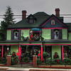 "12/12/10 - Decked out for the Holidays!<br /> <br /> One of the older homes in Monroe fixed up and decked out for the holidays.  Joey drew my attention to this because of the nutcracker center 2nd story:-)  I think we counted 7 nutcrackers total.<br /> <br /> Night version:<br /> <br /> <a href=""http://fotomom.smugmug.com/Nature/December-2010/14895654_UF6nz#1123125440_ycBq6"">http://fotomom.smugmug.com/Nature/December-2010/14895654_UF6nz#1123125440_ycBq6</a><br /> <br /> Obviously I wish the power line wasn't in the shot.  Not one of my best shots, but what I had from yesterday that you might enjoy.  My Marbles pics were uploading from another computer at home yesterday when I left for my dad's house, and for some reason the upload didn't finish.  I had planned to copy over another one of those shots for today, but they aren't on the HD of the machine with me.  Gotta love traveling complications.  Not!<br /> <br /> Enjoying the visit with dad.  Too short, though.  Looks like rain for the entire drive home this afternoon:-(<br /> <br /> HAGD,<br /> Maryann"