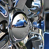 "08/22/11 - Reflections<br /> <br /> I really had trouble focusing on the big picture at the car show.  There were so many neat reflections and interesting close-ups, that I had to keep reminding myself to take pictures of the cars themselves.  Pictured here in the chrome wheel cap of a Chevy Truck is a 1939 Plymouth with a  5.0 liter Ford V-8 engine in it.  See the full car here:<br /> <br /> <a href=""http://fotomom.smugmug.com/CarShows/Capital-City-Car-Show-082111/18640155_3d6cvd#1440103063_DrjP7KQ"">http://fotomom.smugmug.com/CarShows/Capital-City-Car-Show-082111/18640155_3d6cvd#1440103063_DrjP7KQ</a><br /> <br /> Here's the full 1951 Chevy Truck with the actual chrome wheel cap:<br />  <br /> <a href=""http://fotomom.smugmug.com/CarShows/Capital-City-Car-Show-082111/18640155_3d6cvd#1440102950_pmKbB7J"">http://fotomom.smugmug.com/CarShows/Capital-City-Car-Show-082111/18640155_3d6cvd#1440102950_pmKbB7J</a><br /> <br /> Two other reflections that I took and liked are:<br /> <br /> <a href=""http://fotomom.smugmug.com/CarShows/Capital-City-Car-Show-082111/18640155_3d6cvd#1440107219_98QGhWB"">http://fotomom.smugmug.com/CarShows/Capital-City-Car-Show-082111/18640155_3d6cvd#1440107219_98QGhWB</a><br /> In that one you see city buildings on a chrome air filter cap but they are quite abstract.<br /> <br /> And there's a neat reflection in this chrome head light too:<br /> <br /> <a href=""http://fotomom.smugmug.com/CarShows/Capital-City-Car-Show-082111/18640155_3d6cvd#1440102053_7Cj9Gzg"">http://fotomom.smugmug.com/CarShows/Capital-City-Car-Show-082111/18640155_3d6cvd#1440102053_7Cj9Gzg</a><br /> <br /> Thanks for all your comments on my chrome shot from yesterday and a special thanks to those of you who had a few minutes to look at the car show gallery...<br /> <br /> HAGD,<br /> Maryann"