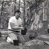 06/29/11 - A Passion for Plants<br /> <br /> This is a picture of my dad, Irv, taken around 1980.  We had just moved from NJ to NC, and dad was out in the yard planting.  I suspect I took this photo although I don't remember it specifically.  Dad loved to work in the yard.  When dad built  the house in NJ in 1964, it was an acre with a sole sycamore tree on it.  When we left in 79, it was covered in plants including dogwood, blue spruce, peony, and ginkgo.  In NC, dad knew he wanted trees, and the new house was built on an acre covered in oaks.  Still, dad set out to plant azaleas, camellias, magnolias.  Although the yard is a shell of what it once was, most that knew dad will in some way remember his love of plants.<br /> <br /> Dad died yesterday.  I know I owe much of what I turned out to be to him.  His patience, kindness, love, and support will always be remembered.  <br /> <br /> Irving Engel 2/15/37 - 6/28/11<br /> <br /> Thank you for your comments on my B&W door from yesterday...<br /> <br /> HAGD,<br /> Maryann