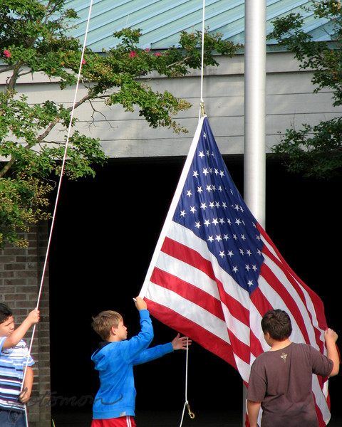 "08/12/10 - Raising the Flag<br /> For the past 2 weeks during morning carpool drop-off at school, I've been watching a group of kids come out to raise the flag.  I was both intrigued and proud and glad to see this tradition and symbol of freedom alive and strong with the next generation.  Yesterday I decided to be a few minutes early and to park after I got through the carpool line so that I could watch the entire ceremony and take some pics.  The boys didn't know I was there; I think it keeps the shot natural.  This isn't meant to be a shot of these boys; it could be a shot of kids at any US school raising the flag.  <br /> <br /> I am hoping that Joey and Johnny will have this honor at school some day, and I showed them the picture last night and we talked about that.  Joey seemed to have a sense of awe and said that it was a ""hard job"".  I told him it wasn't hard but that it did have to be performed with respect and procedure.<br /> <br /> So, in my quest to try something different and focus on people a bit more, I thought I'd share this picture with you today.  I was a bit choked up afterward. It was a proud mom moment even if those weren't my boys.  It was also a reflective moment as remembered those that have sacrificed so that we may have this freedom.  I hope this shot touches you in some way positive today,<br /> <br /> Two other points.  The NC flag was also raised under the US flag appropriately.  Joey says that they do say the pledge of allegiance at his school every morning.  <br /> <br /> I was tempted to share another food shot:<br /> <br /> <a href=""http://fotomom.smugmug.com/Nature/August-2010/13178134_KQNMz#966918558_oxp7u"">http://fotomom.smugmug.com/Nature/August-2010/13178134_KQNMz#966918558_oxp7u</a><br /> Hungry for Italian now?<br /> <br /> Thanks for your comments on the peppers. I really enjoyed the 'food' feedback the last two days:-)<br /> <br /> I want to add too that although this is a very American shot, I do have the utmost respect for the flags of other nations and their sense of national pride and cultural traditions as well.  <br /> <br /> HAGD,<br /> Maryann"