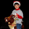 "12/15/09 - Johnny and the Gold-Nosed Reindeer<br /> It was 8pm last night, and I hadn't taken any pictures.  Something got me thinking about this reindeer that I bought years ago still being wrapped up in the attic.  So I went up and grabbed him for an impromptu photo shoot with Johnny.  This was taken in our bonus room with my bed comforter thrown over the couch to provide the dark background.  I bumped up the contrast in this shot to smooth out the black some.  And, I cropped it square.  We had such a delightful time for 15 minutes singing Christmas carols and him giggling and posing and riding the reindeer:-)  One of my other favs is here:<br />  <a href=""http://fotomom.smugmug.com/Nature/December-2009/10503706_iqUUs#741334999_GzGnP"">http://fotomom.smugmug.com/Nature/December-2009/10503706_iqUUs#741334999_GzGnP</a><br /> I think I like the white pompom on the end of the hat showing in that one.<br /> <br /> Johnny singing Jingle Bells in this video (with Joey not too happy in the background):<br />  <a href=""http://fotomom.smugmug.com/Nature/December-2009/10503706_iqUUs#741371674_hTmv8-A-LB"">http://fotomom.smugmug.com/Nature/December-2009/10503706_iqUUs#741371674_hTmv8-A-LB</a><br /> <br /> Maybe more on the reindeer tomorrow.  There is more to the story.<br /> <br /> I sent Mr. Gerberich an e-mail with a link to the collage to see what he thinks of the elf.  Thanks to those that stopped by to see our project:-)<br /> <br /> HAGD,<br /> Maryann"