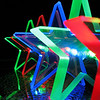 """11/03/09 - Colorful Stars<br /> This is a string of lights I bought at Target in the after Christmas sale last year.  They are acrylic with LED lights.  They were on my mantle for several months earlier this year.  I had wanted to play with them and the camera when they were up but never got to it.  With the cloudy weather again yesterday, I found it nearly bedtime wtih no good picture of the day.  So...  If I could darken the tip of the closest green star a bit, I'd be happier with this.  Some filters applied, but don't ask me exactly what I did because I don't remember...was experimenting.  Another that I experimented with is here:<br />  <a href=""""http://fotomom.smugmug.com/Art/Colorful-Stars/10190074_XCny2#701952933_2FfmC"""">http://fotomom.smugmug.com/Art/Colorful-Stars/10190074_XCny2#701952933_2FfmC</a><br /> At first I thought absolutely don't show the light within the star...just shoot the edges, but then I did shoot some like this one with the light, and I ended up mostly liking those better.<br /> <br /> We had an opossum visit us for dinner last night.  He was drinking on the porch rail bird bath I have right outside my kitchen sink window during dinner last night.  Lucky for him, I'd just made chicken soup, so I quickly went and threw all the scraps out for him.  The boys and I delighted at watching him twitch his nose searching for just exactly where the chicken was.  I took a short video (dark) and a blurred picture (he would not be still) that are also in my star gallery for now.<br /> <br /> HAGD,<br /> Maryann<br /> Note to self: You do not type well in the morning when you haven't had coffee yet!"""