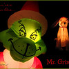 "12/4/09 - Mr. Grinch<br /> This inflatable is a fixture at our house each Christmas.  Unlike the other inflatables which are out near the road, he greets you as you come down the driveway.  He showed up a few Christmas' ago, and the boys just love him as well as the other kids that stop by.  We've got the book, several variations on the book, the DVD, and several other stuffed versions of him...  He looks nicely converted to the Christmas spirit in this version dontcha think?!?  :-)<br /> <br /> In my quest to continue to build Christmas cards I don't need and to bring you a POTD that you'll enjoy, I created this last night.  I pulled the Grinch out of one picture and Max the dog out of another and built this on just a black background.  I had to spend a lot of time of Grinch's face fixing it up because of where the lightbulb sits and how it blew out his right eye.<br /> <br /> You can see the full inflatable here:<br />  <a href=""http://fotomom.smugmug.com/Nature/December-2009/10503706_iqUUs#731176936_k5GgT"">http://fotomom.smugmug.com/Nature/December-2009/10503706_iqUUs#731176936_k5GgT</a><br /> I took pictures of the rest of our outside decorations too.<br /> <br /> Next up...maybe a picture of my snowglobe collection or to feature on of the snowglobes.  We'll see.<br /> <br /> At first Max wasn't in the shot, but then there was just too much real estate on the right.<br /> <br /> Thank you all so much for your wonderful comments on yesterday's ornament shot.  They inspire me to continue to come up with even better ideas and to take even better pictures.  There are a lot of great pictures on the dailies ever day, and I continue to enjoy looking at and commenting on your pictures too.  You all are a great bunch of folks.  <br /> <br /> But, now, if I don't stop spending all my time in PSE, the real Christmas cards aren't going to get in the mail before 2010!  Or, I'm going to have to call in reinforcements to help.  <br /> <br /> The real Christmas card:<br />  <a href=""http://fotomom.smugmug.com/Nature/December-2009/10503706_iqUUs#731442376_wXxs9"">http://fotomom.smugmug.com/Nature/December-2009/10503706_iqUUs#731442376_wXxs9</a><br /> <br /> HAGD,<br /> Maryann"