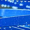 "03/10/11 - Wet and Blue<br /> <br /> This is a picture I took Sunday at Marbles Kids Museum.  I took a short break out in the courtyard while the kids were nearby having fun.  I saw the water drops on this piece of art through the window, and just had to go see it up close and see if I could take any interesting pics of it.  I took about 30 shots total, and it was hard to pick a favorite, but I think this is the one I like the best.  <br /> <br /> The picture of the entire piece of metal artwork is here:<br /> <br /> <a href=""http://fotomom.smugmug.com/Nature/March-2011/16046070_gZarf#1208315558_G7QDb"">http://fotomom.smugmug.com/Nature/March-2011/16046070_gZarf#1208315558_G7QDb</a><br /> <br /> Raining here today too.  I long to be out in the sun and taking more spring flower pictures, but it just hasn't worked out.  <br /> <br /> Johnny survived his 6 month dental cleaning yesterday.  I wanted to take a few pics while we were there, but I resisted.  <br /> <br /> Thanks for your comments on Johnny and the CFA cow.  I spotted 2 small issues with the shot late in the day yesterday and went in and created a corrected version.<br /> <br /> HAGD,<br /> Maryann"