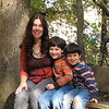 11/08/09 - Me and the Boys... (Left to right me, Joey, and Johnny)<br /> The boys and I spent most of the day outside yesterday.  We started the day off at the Carroll Howard Johnson Environmental Education Park in Fuquay.  Not a new park, but a new to us park.  This park has about 2 miles of wide trails and a creek that winds through it.  The boys loved playing in the creek at various spots, and we saw deer tracks and other neat wildlife/nature things while we were there.  I took my lightweight tripod with me and took pictures of all sorts of things including shadows on tree trunks, waterscapes, moss, leaves, tree stumps, etc.  But, I also set up the timer to take a few pics of me and the boys, and when I sat down to figure out which picture to post...well this was the winner.  <br /> <br /> Johnny had such a good time at the park, that I had to put him in a new pair of pants afterward:-)  Wet and sandy!<br /> <br /> Too windy to go to Yates Mill yesterday to try one more water reflection shot, but maybe today.<br /> <br /> Thank you so much for your feedback on the bench. I loved reading in the comments how each of you reacted to it.  <br /> <br /> Hope you're having a great weekend!<br /> Maryann