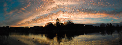 March 10  I had been watching beautiful cloud patterns during the afternoon, hoping that there was going to be a nice sunset show! This shot was taken at Atascadero Lake; a small lake, adjacent to a pretty park and Zoo, minutes from my home.  This was the first time I've used 'Photomerge' to create a panarama.