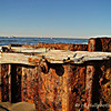 1.29.11<br /> <br /> Seen on the beach, Santa Barbara, CA<br /> <br /> No idea what purpose this structure serves, or served, but <br /> I liked the texture of the rust and wood.