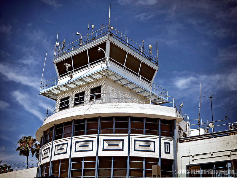 """""""C"""" is for Control Tower,<br /> for Donna's Alphabet Challenge...<br /> <br /> Long Beach Airport<br /> Long Beach, CA<br /> <br /> The first transcontinental flight, a biplane flown by Calbraith Perry Rodgers, landed in 1911 on Long Beach's sandy beach. From 1911 until the airport was created, planes used the beach as a runway.<br /> The famous barnstormer Earl S. Daugherty had leased the area that later became the airport for air shows, stunt flying, wing walking and passenger rides. Later, he started the world's first flight school in 1919 at the same location. In 1923 Daugherty convinced the City council to use the site to create the first municipal airport. <a href=""""http://www.wikipedia.org/wiki/Long_Beach_Airport"""">http://www.wikipedia.org/wiki/Long_Beach_Airport</a><br /> <br /> Thank you for your comments, much appreciated!<br /> <br /> Critiques welcome...<br /> <br /> In the end, people appreciate honest criticism far more than flattery. Provers 28:23 NLT <a href=""""http://www.biblegateway.com"""">http://www.biblegateway.com</a><br /> <br /> 28 July 2013"""