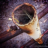 rust and texture...<br /> <br /> I took this several months ago and had forgotten about it. I kind of liked the rust and texture. Also liked the pine needles and spider web inside the pipe. The perspective seems to make the pipe look much taller than its' actual 4-5 feet...best viewed in larger sizes.<br /> <br /> Thanks again for your comments!<br /> <br /> Critiques welcome...<br /> <br /> 19 June 2013