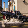 OOOPS!<br /> <br /> No idea how the driver of this pickup managed to back up over this fire hydrant, but he/she did! Water everywhere! Everyone, including yours truly, had their cameras clicking! Fortunately, I don't believe anyone was hurt. Quite a sight!<br /> <br /> Critiques welcome...<br /> <br /> As always, thanks for your comments! <br /> <br /> February 26, 2013