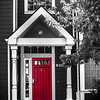 Red Door...  This house was gray and white to begin with but I wasn't happy with the original color version so converted it to black and white...except for the red door : )  Historical District Whittier, CA  Hadley-Greenleaf Historic District Whittier, CA  The Hadley-Greenleaf Historic District was designated by the City of Whittier in 1990 and includes over 190 individual properties. The Hadley-Greenleaf Historic District includes a variety of architectural styles including: Victorian, Spanish Colonial Revival and Craftsman type homes. http://www.cityofwhittier.org/depts/cd/planning/histpres/districts.asp  Thank you for your comments!  Critiques welcome...  May 21, 2013