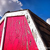 Red, White and Blue...<br /> <br /> My wife and I pass this small red shed whenever we go walking. We can only see this portion, as the rest is behind a fence. I've liked the colors, the peeling paint and the texture, and thought it might be worth a shot. I have to confess though, that I did swap out the original clear blue sky for this one, as the clouds added a little more interest.  : )<br /> <br /> Thank you for your comments, very much appreciated!<br /> <br /> Critiques welcome...<br /> <br /> February 2, 2013