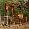 "Stearns 104... <br /> <br /> This well obviously hasn't been pumping for a while, but the rust made up for that, just had to take a shot!<br /> <br /> The Brea-Olinda Oil Field is a large oil field in northern Orange County and Los Angeles County, California, along the southern edge of the Puente Hills, about four miles (6 km) northeast of Fullerton, and adjacent to the city of Brea. Discovered in 1880, the field is the sixteenth largest in California by cumulative production, and was the first of California's largest 50 oil fields to be found.[1] It has produced over 412 million barrels of oil in the 130 years since it was first drilled, and retains approximately 19 million barrels in reserve recoverable with current technology. As of the beginning of 2009, 475 wells remained active on the field, operated by several independent oil companies, including Linn Energy, BreitBurn Energy Partners L.P., Cooper & Brain, and Thompson Energy.  <a href=""http://en.wikipedia.org/wiki/Brea-Olinda_Oil_Field"">http://en.wikipedia.org/wiki/Brea-Olinda_Oil_Field</a><br /> <br /> Thanks for your comments, have a good week!<br /> <br /> Critiques welcome...<br /> <br /> April 29, 2013"