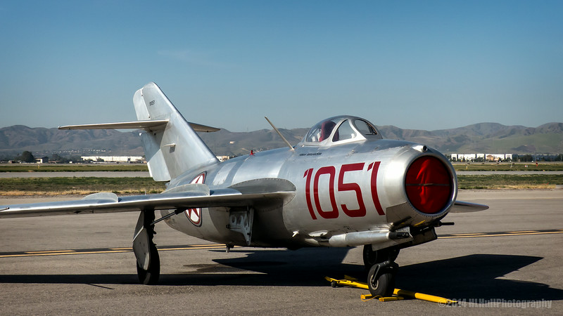 """Mokoyan-Gurevich MIG-15<br /> <br /> The Mikoyan-Gurevich MiG-15 (Russian: Микоян и Гуревич МиГ-15; NATO reporting name: """"Fagot"""") is a jet fighter aircraft developed by Mikoyan-Gurevich OKB for the Soviet Union. The MiG-15 was one of the first successful swept-wing jet fighters, and achieved fame in the skies over Korea, where early in the war, it outclassed all straight-winged enemy fighters in most applications.<br /> <br /> Later, the MiG-15 would also serve as a starting point for the development of the more advanced MiG-17. The MiG-15 is believed to have been one of the most widely produced jet aircraft ever made, in excess of 12,000 were manufactured. Licensed foreign production may have raised the production total to over 18,000 The MiG-15 is often mentioned along with the North American F-86 Sabre as among the best fighter aircraft of the Korean War and in comparison with fighters of other eras. <a href=""""http://en.wikipedia.org/wiki/Mikoyan-Gurevich_MiG-15"""">http://en.wikipedia.org/wiki/Mikoyan-Gurevich_MiG-15</a><br /> <br /> Planes of Fame Air Show, May 3-4, 2014<br /> Chino Airport<br /> Chino, CA <br /> <br /> Thank you for your views and comments!<br /> <br /> Critiques welcome...<br /> <br /> 10 July 2014"""