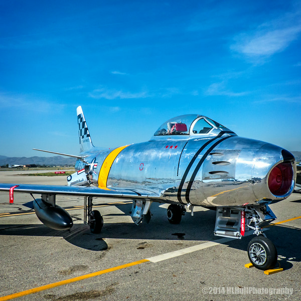 """North American F-86F Sabre...<br /> <br /> The North American F-86 Sabre (sometimes called the Sabrejet) was a transonic jet fighter aircraft. Produced by North American Aviation, the Sabre is best known as the United States's first swept wing fighter which could counter the similarly-winged Soviet MiG-15 in high-speed dogfights over the skies of the Korean War. Considered one of the best and most important fighter aircraft in the Korean War, the F-86 is also rated highly in comparison with fighters of other eras.[3] Although it was developed in the late 1940s and was outdated by the end of the 1950s, the Sabre proved versatile and adaptable, and continued as a front-line fighter in numerous air forces until the last active operational examples were retired by the Bolivian Air Force in 1994. <a href=""""http://en.wikipedia.org/wiki/North_American_F-86_Sabre"""">http://en.wikipedia.org/wiki/North_American_F-86_Sabre</a><br /> <br /> Planes of Fame Air Show, May 3-4, 2014<br /> Chino Airport<br /> Chino, CA<br /> <br /> Thank you for your veiws and comments!<br /> <br /> Critiques welcome...<br /> <br /> 7 July 2014"""