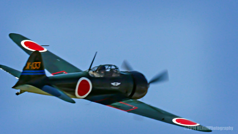 "Mitsubishi A6M5 Zero/Reisen/Zeke...<br /> <br /> HISTORY<br /> <br /> Completed in May 1943, Zero No 61-120 was the 2,357th aircraft of its type to come off the Nakajima production line and was first assigned to the Japanese Naval Air Corps on the home island of Honshu. In a few months, it moved to Iwo Jima, then in March 1944, was reassigned to Asilito Airfield on Saipan.<br /> <br /> On June 18, 1944, U.S. Marines captured Asilito Airfield with a number of intact Zero fighters. A dozen of these intact Zeros were shipped to NAS North Island, San Diego, California, USA for evaluation. Four Zeros were restored to flight, two went to the Army Air Force and two were retained by the Navy.<br /> <br /> The Museum's Zero No 61-120 was ferried to NAS Patuxent River, Maryland on August 23, 1944 and subsequently flown by about 25 different USN, USMC, Royal Navy and civilian fighter and test pilots, including Charles A. Lindbergh. The aircraft was ferried back to San Diego on January 11, 1945, where frontline combat pilots were also given a chance to check out the Zero. Altogether, Zero No 61-120 logged over 190hr of flight time in the USA before being declared surplus after the war.<br /> <br /> Zero No 61-120 wound up being sold for scrap, but Mr. Ed Maloney obtained it in 1951 for his Air Museum in Claremont, CA, which opened in 1957.<br /> <br /> The Museum began restoring the Zero to flying condition in 1973 and after 4½ years it flew again on June 28, 1978.<br /> <br /> DISTINCTION<br /> <br /> The Museum's Zero is the only fully authentic flyable example in the world.<br /> <br /> Restored to flying condition in June 1978, this Zero fighter is still powered by its original Nakajima Sakae 31 engine.  It carries the same color scheme and markings it bore in combat for the Imperial Japanese Navy during the war.<br /> <br /> After a successful flight-test program the Zero was shipped to Japan for a six-month tour of flight demonstrations.  Two tours have been made in Japan and is the only example of the type of Zero to have flown in Japan since the end of WWII.<br /> <br /> Once flown by Charles A. Lindbergh at NAS Patuxent River, Maryland.<br /> <br /> Movie and TV appearances include Pearl Harbor, Tora Tora Tora  <a href=""http://planesoffame.org/"">http://planesoffame.org/</a><br /> <br /> Planes of Fame Air Show, May 3-4, 2014<br /> Chino Airport<br /> Chino, CA<br /> <br /> Thanks for your views and comments! Critiques welcome...<br /> <br /> 22 July 2014"