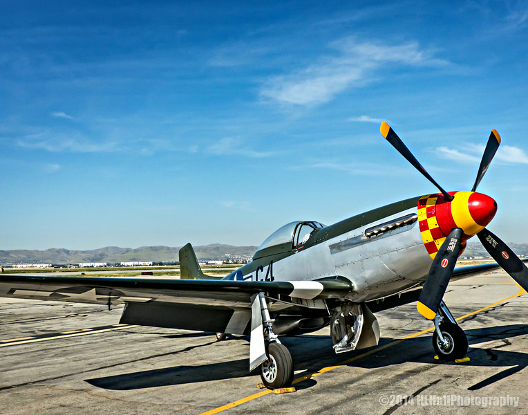 """North American P-51 Mustang...<br /> <br /> The North American Aviation P-51 Mustang was an American long-range, single-seat fighter and fighter-bomber used during World War II, the Korean War and other conflicts. The Mustang was conceived, designed and built by North American Aviation (NAA) in response to a specification issued directly to NAA by the British Purchasing Commission. The prototype NA-73X airframe was rolled out on 9 September 1940, 102 days after the contract was signed and, with an engine installed, first flew on 26 October.<br /> <br /> At the start of the Korean War, the Mustang was the main fighter of the United Nations until jet fighters such as the F-86 took over this role; the Mustang then became a specialized fighter-bomber. Despite the advent of jet fighters, the Mustang remained in service with some air forces until the early 1980s. After World War II and the Korean War, many Mustangs were converted for civilian use, especially air racing, and increasingly, preserved and flown as historic warbird aircraft at airshows. <a href=""""http://en.wikipedia.org/wiki/North_American_P-51_Mustang"""">http://en.wikipedia.org/wiki/North_American_P-51_Mustang</a><br /> <br /> Planes of Fame Air Show, May 3-4, 2014<br /> Chino Airport<br /> Chino, CA<br />  <a href=""""http://planesoffame.org/"""">http://planesoffame.org/</a><br /> <br /> Thank you for viewing and commenting, much appreciated!<br /> <br /> Critiques welcome...<br /> <br /> 9 August 2014"""