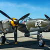 "Lockheed P-38 Lightning...<br /> <br /> Easily one of the most recognizable fighters of its time because of its distinctive twin-boom design, the Lockheed P-38 Lightning was one of the most famous American warplanes of World War Two and the mount of America's two top aces—Dick Bong, who scored 40 aerial victories, and Tommy McGuire, who was credited with 38 kills. However, although more than 10,000 Lightnings were built during the war, the big fighter did not fit into the Air Corps' post-war plans and was soon retired from service.<br /> <br /> Today, there are probably fewer than a score of intact Lightning airframes left in the world and only about half a dozen of those are flyable or restorable to flying condition. The most recent Lightning to be restored to flying condition is P-38J-20-LO serial 44-23314 which, after 28 years of inactivity, took to the skies once more at the Chino Airport in Southern California on July 22, 1988. Bearing the civil registration N29Q, this aircraft belongs to the Planes of Fame Air Museum's collection and was the object of a 13-month restoration project by Steve Hinton's Fighter Rebuilders crew at Chino and ""Planes of Fame"" volunteer workers.<br /> <br /> Including its wartime service with the Army Air Corps, 44-23314 had a total of only 121hr on its airframe before restoration. It just flew for a short time with training squadrons in Texas and Florida during the last year of the war before being declared surplus. <a href=""http://planesoffame.org/"">http://planesoffame.org/</a><br /> <br /> Planes of Fame Air Show, May 3-4, 2014<br /> Chino Airport<br /> Chino, CA <br /> <br /> Thanks for your views and comments!<br /> <br /> Critiques welcome...<br /> <br /> 14 July 2014"