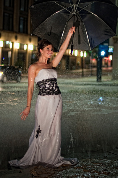 "July 10, 2010 - ""Glamor In The Fountain""<br /> <br /> Here's another image from the Thursday night SMUG photo shoot.  The models were terrific especially considering being in those wet heavy dresses for 1 -2 hours.<br /> <br /> I originally had planned on using a zoom lens, but it was pretty dark when we started shooting.  So I switched to my fast 50mm prime lens and was able to get quite a few shots without a flash.  The lighting in this photo was provided with a handheld battery powered light."