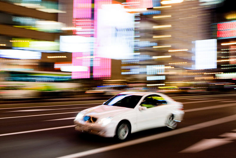 The bright lights of Sapporo! <br /> <br /> An attempt at panning. I would have loved to use the flash, but I really didn't want to be responsible for a car accident.