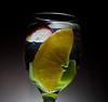 I attempted to get some fruit falling into water, but completely gave up, and just ended up with a bunch of fruit in water. lol. oh well... if anyone has some good tips of how to get a good fruit-falling-into-water-shot, I would appreciate it. I want to get a completely black background, no reflections on the glass, and I can't figure out where to position my flash... These are a few of the troubles I was having.