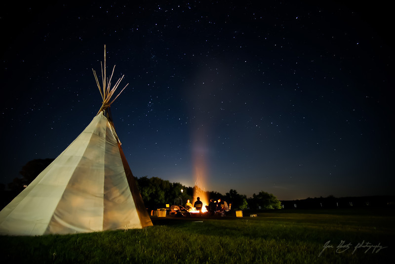 In the summer of 2008, I had the opportunity to travel to the small community of Clearwater for a travel-study program offered through the University of Manitoba. For me, this photo freezes a moment in time, where friends sit around a fire singing together, and appreciating the vast beautiful landscape that is Manitoba.
