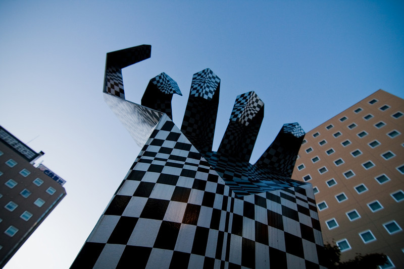 Abstract metal hand coming out of the streets of Obihiro.