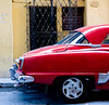 Its been exactly a year since I was in Cuba. I was going through some of my shots and decided that I like this one. This car was passing by, and in the narrow streets of Havana, I couldn't back up far enough to get the whole car with the lens I had on, but I think it still works.