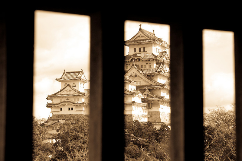 "A glimpse of Himeji Castle<br /> I find this photo to be such a contrast between yesterdays photo which might represent the dramatic changes in Japan. <br /> <br /> Check out the rest of the shots! It has to be Japans most beautiful castle. <br />  <a href=""http://joeygoertz.smugmug.com/Travel/Honshu/Honshu/10896103_n8AqE#760660081_iNzip"">http://joeygoertz.smugmug.com/Travel/Honshu/Honshu/10896103_n8AqE#760660081_iNzip</a>"