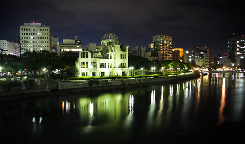 A night-shot of the A-bomb dome in Hiroshima. This building is a stark reminder of the terrible events that happened on August 6, 1945. This city now promotes peace, and is an advocate for the abolition of all nuclear weapons. Ever since the war ended, the mayor of Hiroshima has written letters to world leaders who plan to test nuclear weapons, expressing not only his, but the entire city of Hiroshima's disappointment. The people here know too well the lasting affects of such a destructive weapon. <br /> <br /> After the bomb hit this city, there was practically nothing left but the skeleton of this Czech designed building. As you can see by the surrounding buildings, the city is now doing very well.