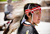 A young boy participating in a First Nations dance on Aboriginal Day.