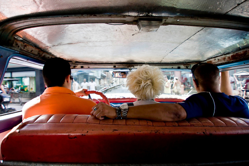"""One of my most favorite shots from Cuba. Sitting in the back seat of one of the old cars in Cuba with a bunch of locals. This is one of the many """"taxi's"""" in Cuba. I love how nothing has been restored in some of these old cars. This one is no exception."""