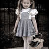 "11-2-2011<br /> ""Toto, We are not in Kansas Anymore.""<br /> <br /> ""Wizard of Oz"" is one my all time favorite movies.  This little girl was dressed as Dorothy at a Halloween party the other night.  You can look at all the costumes in my People Gallery. I thought she was just so cute so I took her photo and then used Topaz BW Effects to make this look.  <br /> <br /> Thanks for your comments even though I do not post everyday.  <br /> Donna"