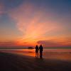 A Couple on the Beach at Dawn