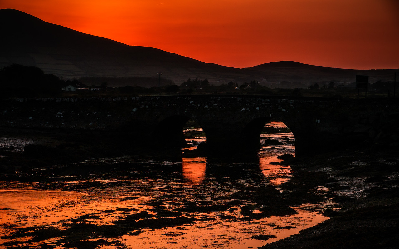 """June 9th 2013 -The sun setting in Dingle ...When  leaving Dingle, for the the Slea Head Drive visitors  pass over Milltown Bridge  (as shown in the picture)<br /> It was very hot yesterday.. I think  today is going to be warmer <br /> """"Met Éireann forecasts more sunshine after hottest day of year"""""""