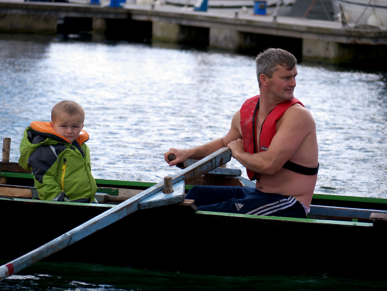 "August 15th 2011 'Father and son at the Dingle Regatta ' I love the look on the kid's face... amazingly we had nice weather here in Dingle yesterday.<br /> The Regatta is an annual celebration of the skill and expertise of the boat men & women from Chorca Dhuibhne operating the Four-Hand Namhóg in Dingle Harbour. <br /> You can see more photographs here<br /> <a href=""http://dinglepeninsula.smugmug.com/Dingle-Peninsula/Dingle-Regatta-2011/18532322_c79dj8"">http://dinglepeninsula.smugmug.com/Dingle-Peninsula/Dingle-Regatta-2011/18532322_c79dj8</a>"
