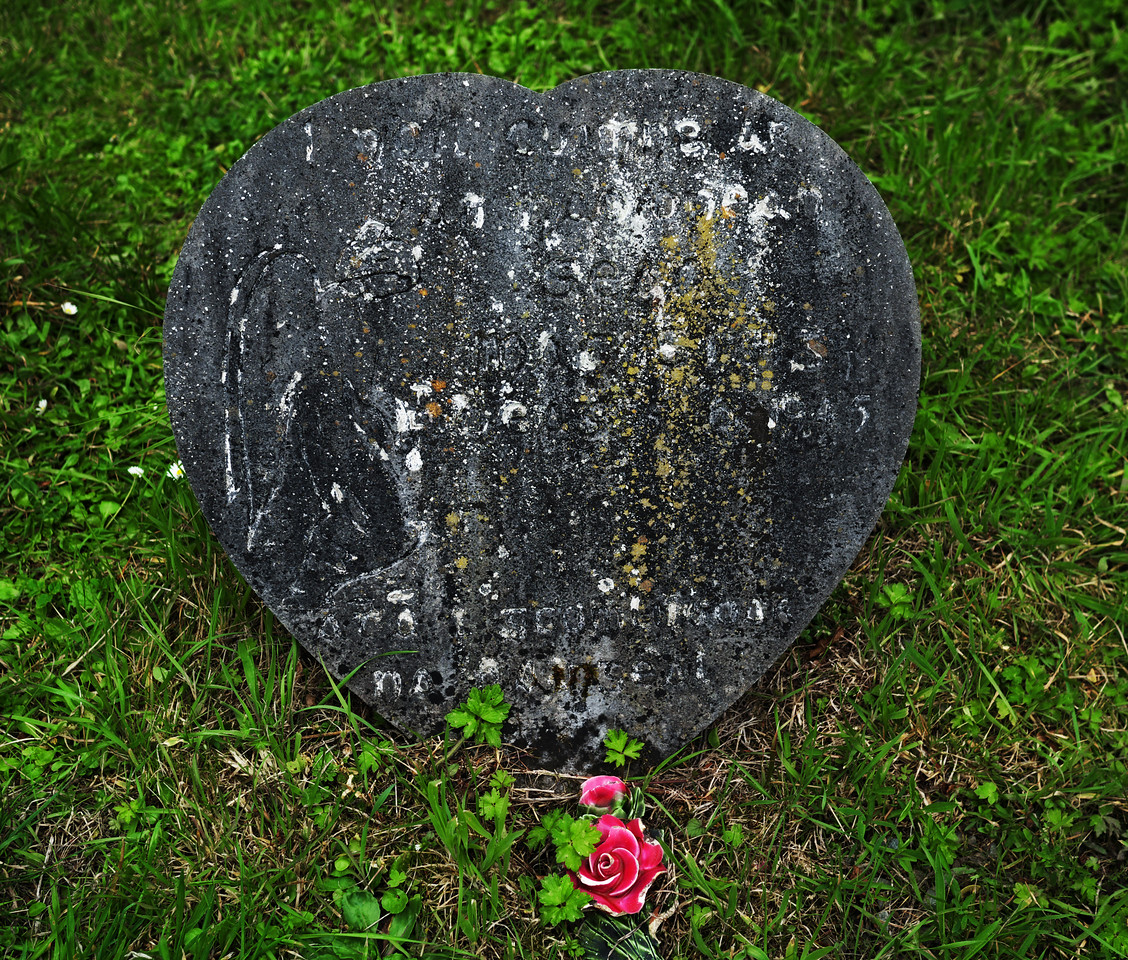 12/09/2011 'Post Sept 11th life goes on'.  Yesterday I decided to visit a graveyard in Balyferriter, Dingle Peninsula.  I suppose I visited it as it was Sept 11th (I know nobody there) Then I saw this beautiful tombstone (made to look like a heart) and the flower in front of  it.  Strangely I felt at peace