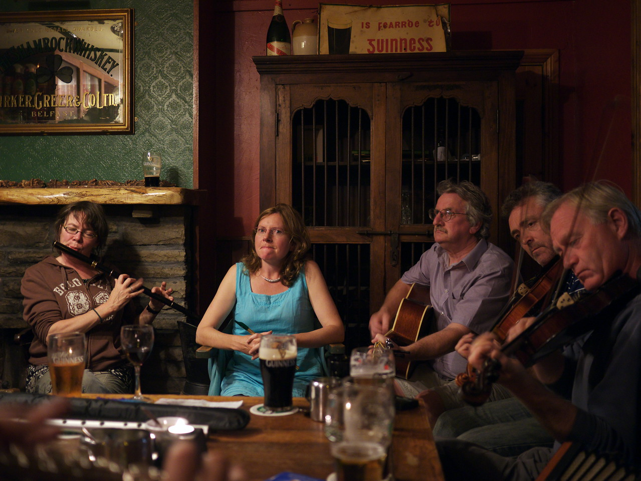 """August 5 2011 'Traditional Music in an Irish Bar' Today is my birthday so last night a friend of mine took be to Ballyferritor a small village 12 miles from Dingle to listen to some Irish music.  It was amazing there was at one time some 12 musicians playing.  This photo does not do justice to the wonderful music that was played last night but at least you will get a small idea what the music was like.<br /> A Youtube video of the music is here...<br /> <a href=""""http://youtu.be/z2f5Ty50xik?hd=1"""">http://youtu.be/z2f5Ty50xik?hd=1</a>"""
