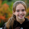 December 6, 2008.<br /> Like I said, there are still some blossoms among the Fall foliage. This flower is my great-niece Alayna.