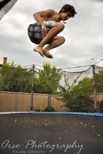 Wednesday, June 3, 2009.<br /> <br /> All 4 of us were having a great time on the trampoline today. We had the water on for a brief moment (then started to get windy and cold and we turned it off). Here is a picture of Gabe taking a break from homework and having some fun.