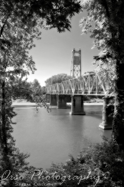 July 15, 2009.<br /> <br /> I took this photo yesterday while we went for a bike ride and I think I like it best in B&W. They just opened this bridge for pedestrians to walk from one park downtown to another. It is pretty cool.
