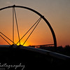 August 21, 2009.<br /> <br /> Another shot taken just outside of Salem, of the sunset as viewed through one of those wheels that holds the sprinklers for the farm land.