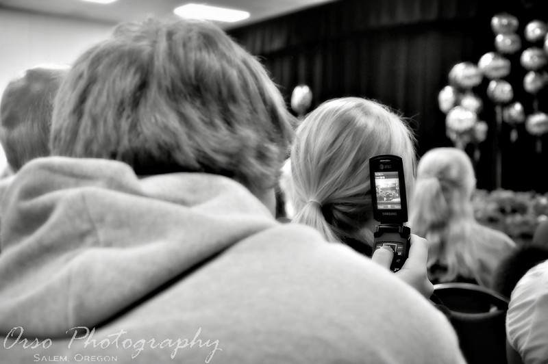 Thursday, June 10, 2009.<br /> <br /> I actually took this shot yesterday during an event for Salem Academy. The 8th Graders were being recognized and 'promoted' for freshman for next school year. I took this shot of our newphew who was sitting next to me as he tried to get a shot of his brother (who just completed 8th grade). Used Photoshop again to add the treatment.
