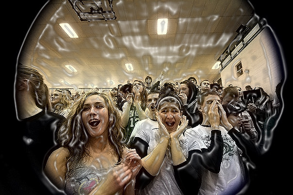 Hey guys, Gabe here, this is a photo i took a while back during basketball season, i thought it represented school spirit well, it was taken with a fish eye lense, (i used a Cannon 1d Mark IIII with a sigma 10-20mm) and i did the PP in photoshop! i hope you enjoy it!!