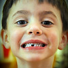 Sunday, March 22, 2009.<br /> <br /> Today's Daily Picture is of Noah. He is our youngest (4 yrs old) and just lost his first tooth today. He was very proud when it happened, which was on the way to church this morning. He walked around with the tooth in his pocket all day, until he placed it under his pillow before beditme.